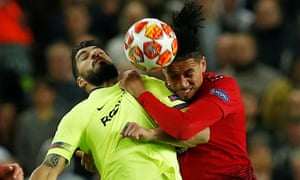 Barcelona's Luis Suarez tussles with Manchester United's Chris Smalling.