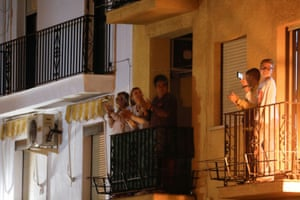 Family members applaud from their balconies during a call on social media to thank Spanish medical staff fighting against coronavirus