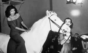 Don't stop the party … Bianca Jagger sits on a white horse at Studio 54 in 1977.