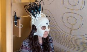 Woman wears new scanner based on magnetoencephalography, or MEG, technology.