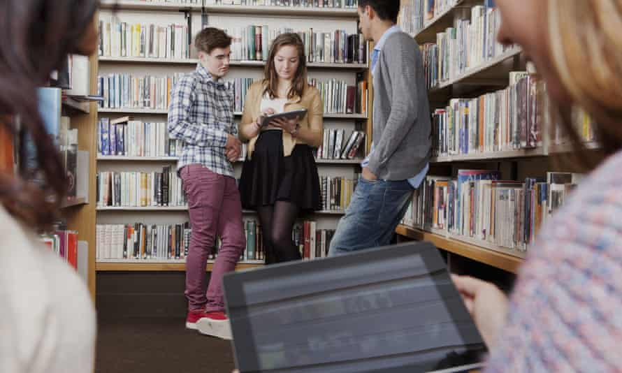 Students in a library with tablet