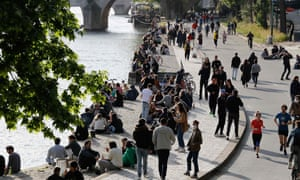 People gather along banks of the Seine river in Paris on 11 May.