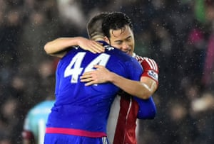 Maya Yoshida and Fraser Forster celebrate at the end of the match.