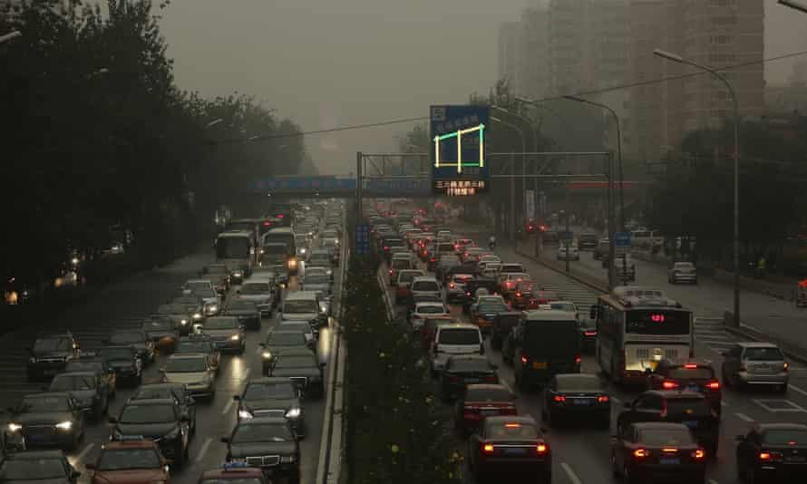 Smog shrouds heavy traffic in downtown Beijing.