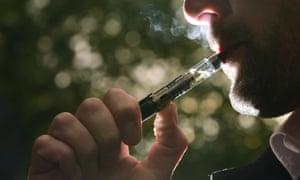 A man vaping, or smoking an electronic cigarette