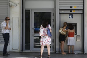 The women right use the ATM machine as two other people wait outside of a closed bank in central Athens, Wednesday, July 8, 2015. Frustrated and angry eurozone leaders fearing for the future of their common currency gave the Greek Prime Minister Alexis Tsipras a last-minute chance Tuesday to finally come up with a viable proposal on how to save his country from financial ruin. (AP Photo/Petros Karadjias)