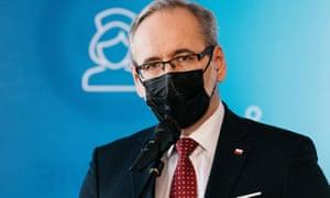 Polish health minister Adam Niedzielski speaks at a press conference.