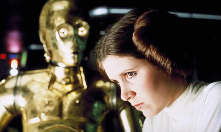 carrie fisher as princess leia with c-3po in star wars
