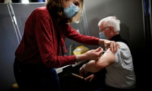 A man receives the Pfizer-BioNTech vaccine at a centre in Paris.