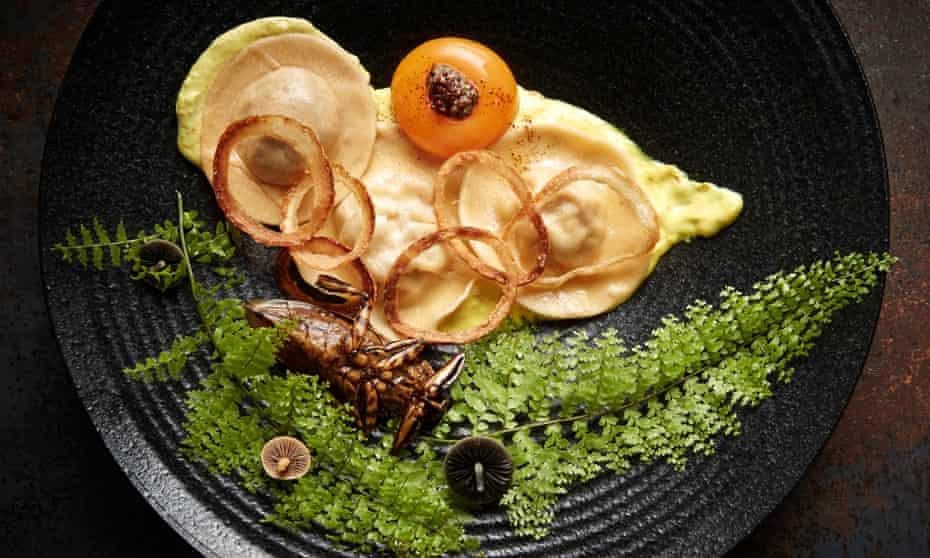 Crab and water beetle ravioli with a turmeric saffron sauce.