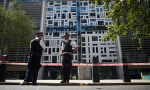 Police guard a cordon near the Home Office in Westminster.