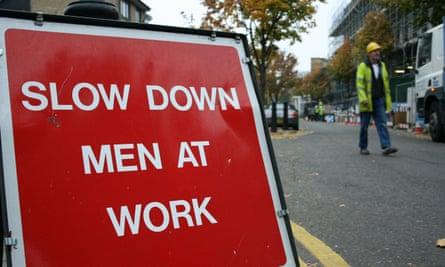 A 'slow down men at work' sign near London Bridge, London.