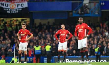 A dejected Ander Herrera, left, Chris Smalling, centre, and Paul Pogba in the wake of Chelsea's third goal at Stamford Bridge on Sunday
