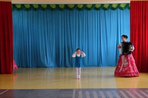 A girl practices a musical performance at a kindergarten in the northern port city of Chongjin
