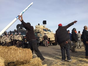 Dakota Access pipeline protesters stand their ground as law enforcement officers approach