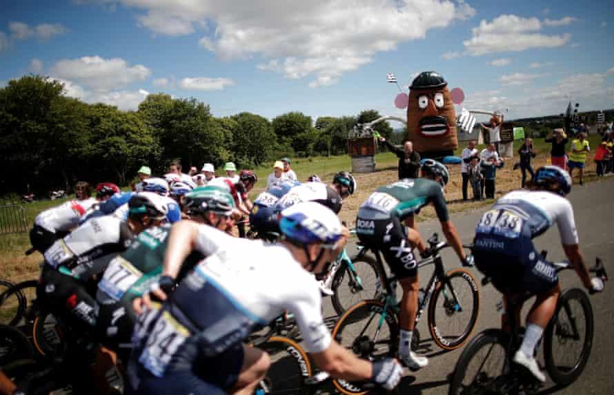 The peloton passes a large Mr Potato Head.