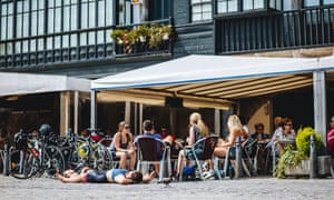 A well-earned rest at a cafe, several cyclists sitting outside at tables