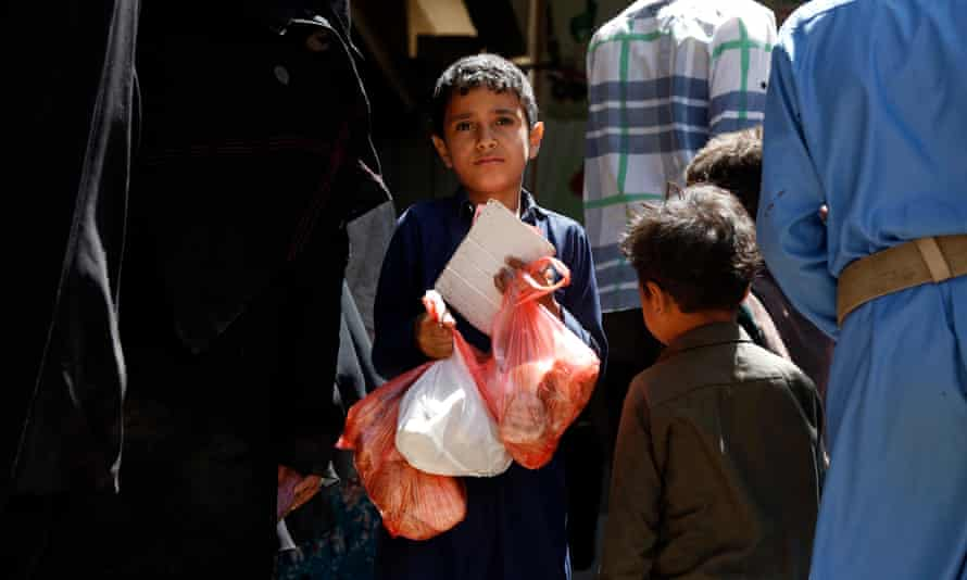 A Yemeni child receives a meal from a charitable centre in Sana'a