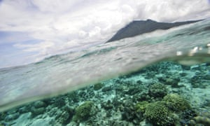 Waves lap a coral reef off Bunaken Island marine protected national park near Sulawesi, Indonesia.