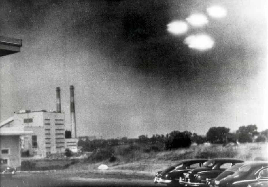 This picture, taken through the window of a laboratory by a 21-year-old US coastguard, shows four unidentified flying objects as bright lights in the sky, at Salem, Massachusetts, on 3 August 1952.
