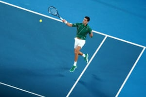 Novak Djokovic of Serbia returns a shot.