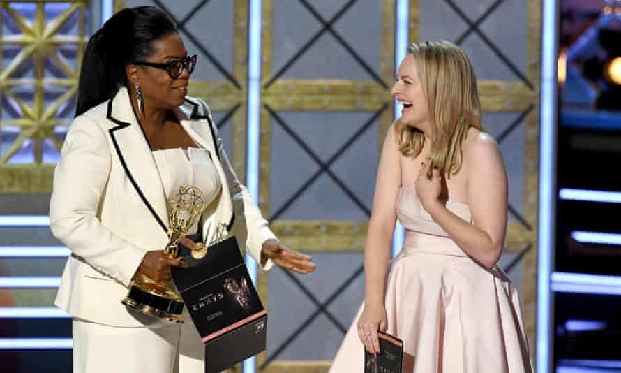 Actor Elisabeth Moss accepts Outstanding Drama Series for The Handmaid's Tale from Oprah Winfrey onstage during the 69th Emmy Awards.