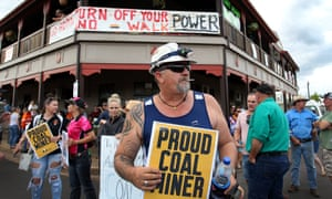 Pro-Adani supporters gather outside the Commercial hotel in Clermont, central Queensland, to protest against the arrival of anti-Adani environmental activists on Saturday.