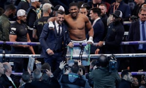 Anthony Joshua celebrates victory with Carl Froch