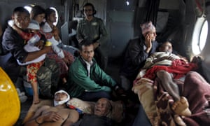 Victims of the earthquake rest inside an Indian Air Force helicopter as they are evacuated from Trishuli Bazar to the airport in Kathmandu.
