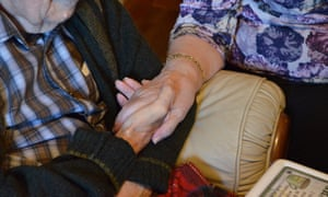 Pensioners holding hands