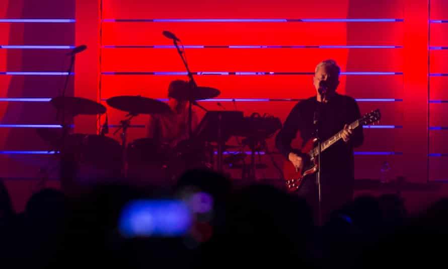 Closer … drummer Stephen Morris and guitarist Bernard Sumner reprise songs by former band Joy Division.