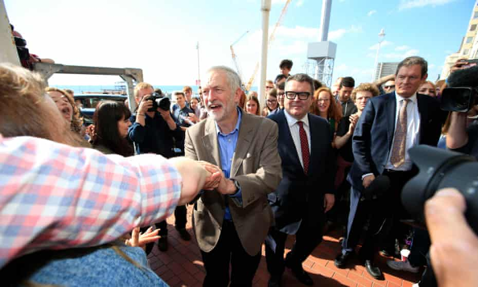Jeremy Corbyn and his deputy Tom Watson greeted by supporters