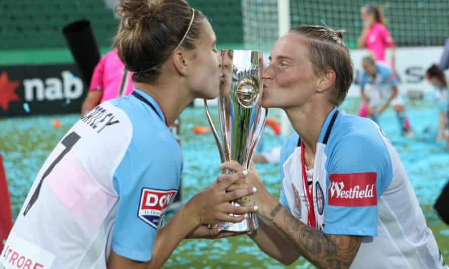 Fishlock, right, celebrates winning February's W-League grand final with Melbourne City team-mate Stehanie Catley. It was the 30-year-old's second successive title and first as player-coach