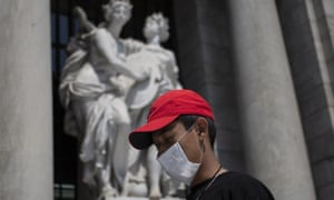 A boy wears a mask, behind of he the Beauty Arts Palace on February 28, 2020 in Mexico City, Mexico. The Secretariat of Health of Mexico has announced the first two confirmed cases of Covid-19.
