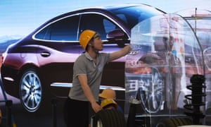 A worker at a Buick stand at a car exhibition