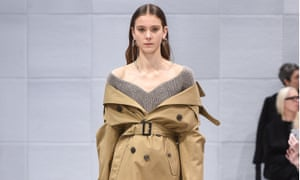 A model in Balenciaga's autumn/winter 2016 show in Paris shows us how to 'shoulder disrobe'.
