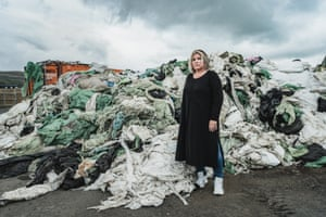 Aslaug (Asa), co-founder of Pure North Recycling, in front of disposed plastic ready to be recycled
