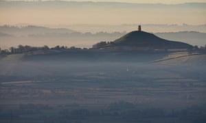 The December sun rises over Glastonbury in Somerset.