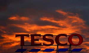 Tesco sign and red sky