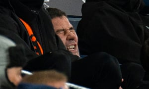 Burton Albion manager Nigel Clough shrinks in his seat as Manchester City's Riyad Mahrez scores the ninth goal