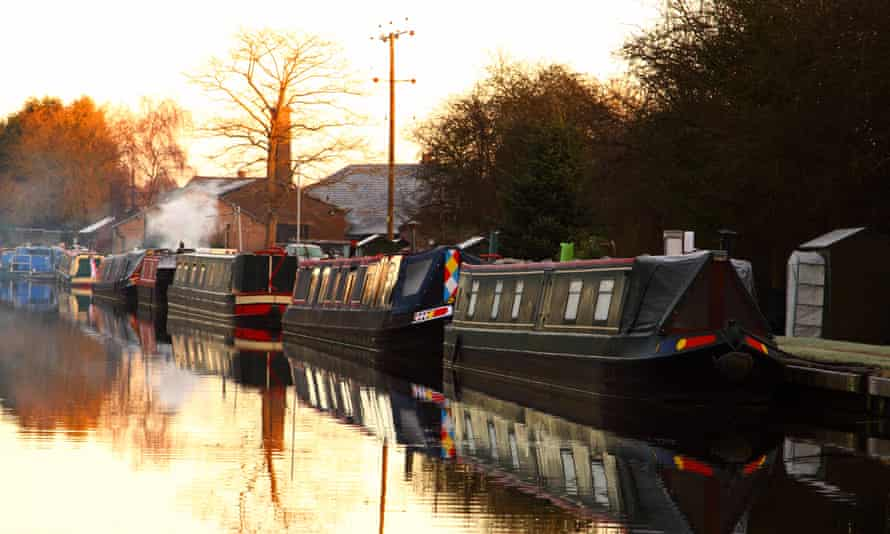 Barges at sunrise at Norbury Junction on the Shropshire Union Canal in Staffordshire.