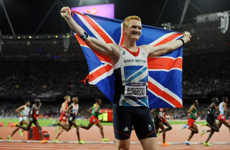 Greg Rutherford celebrates after winning the men's long jump