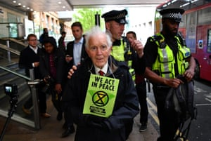 London, England Police remove Phil Kingston, an 83 year old Extinction Rebellion protester, during a demonstration blocking traffic at Canary Wharf station