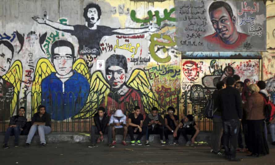 Demonstrators rest at Mohamed Mahmoud Street, Cairo, 2013