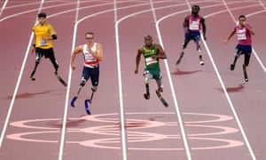 South Africa's Ntando Mahlangu (centre) wins the men's 200 metres T61 final ahead of second placed Great Britain's Richard Whitehead.