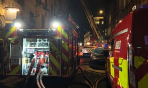 Firefighters tackle a blaze in a six-storey building in Holborn, London, on Sunday morning.