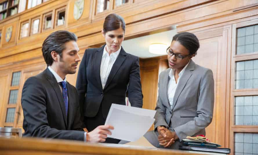 Stock image of lawyers in courtroom.