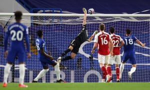 Chelsea's Kurt Zouma (second left) watches as his header smacks against the bar.