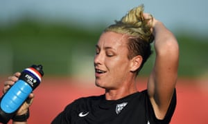 Abby Wambach cools off during training.