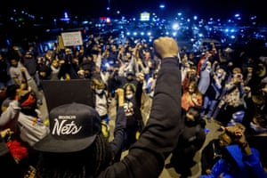 Johnie Franklin, a lifelong Flint resident and organiser,  leads hundreds into a 15-second moment of silence for George Floyd and others whose lives have been lost to police brutality, during a peaceful protest in Michigan